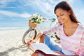 Beach bicycle woman reading book Royalty Free Stock Photo