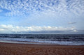 Beach and blue cloudy sky by the sea on sundown Royalty Free Stock Photo