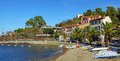 Beach with boats and hotel restaurant in collioure village roussillon pyrenees orientales vermilion coast france Royalty Free Stock Photos