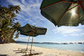 Beach boracay sun umbrella with chair longues on tropical philippines Royalty Free Stock Photography