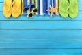 Summer background beach border flip flops sunglasses copy space Royalty Free Stock Photo