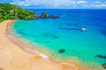 Beach in brazil with a colorful sea fernando de noronha green turquoise and blue water Royalty Free Stock Photo