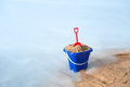 Beach bucket in sand Royalty Free Stock Photography