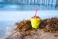 Beach bucket in sand Stock Image