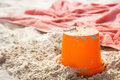 Beach bucket tiy and towel on beach sand Royalty Free Stock Photos