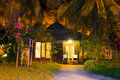 Beach bungalow at night Stock Photo