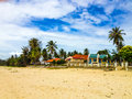 Beach bungalows among palm trees at thung wua laen thailand Royalty Free Stock Images