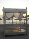 Beach canopy and parasols at sunrise Royalty Free Stock Photo