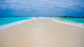 Beach in caribbean with a sand pathway blue water and connecting two islands Stock Photography