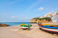The beach of carvoeiro with fishing boats in the at village foreground portugal summer Royalty Free Stock Image