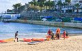 Beach in cascais portugal children with boats on shore Royalty Free Stock Photography