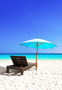 Beach chair and beautiful sand beach with umbrella Royalty Free Stock Photography