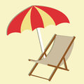 Beach chair on light yellow background Royalty Free Stock Photo