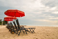 Beach chair with red umbrella on Hua Hin Beach, Phetchaburi, Tha Royalty Free Stock Photo