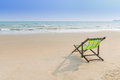 Beach chair on the sand  lonely concept Royalty Free Stock Photo