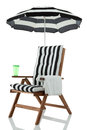 Beach chair with towel and drink Royalty Free Stock Image