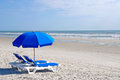 Beach Chairs with Blue Umbrella Royalty Free Stock Photo