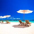 Beach chairs on exotic tropical white sandy beach see my other works in portfolio Stock Photo