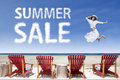 Beach chairs and girl jumping for summer sale Royalty Free Stock Photo