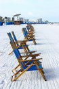 Beach chairs a line of is set up every morning on the for rent Royalty Free Stock Photos