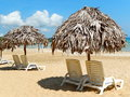 Beach chairs on perfect tropical white sand beach under a blue sky Stock Photography