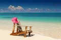 Beach chairs with pink hat on white sand sandy Royalty Free Stock Photo