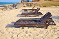Beach chairs on sand beach. Concept for rest, relaxation, holida