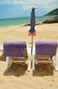 Beach chairs on sand in front of beach tropical Royalty Free Stock Photos