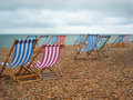Beach Chairs on the shore at Brighton England Royalty Free Stock Photo