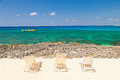 Beach chairs on a small beach in cayman islands Stock Images