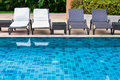 Beach chairs swimming pool with Royalty Free Stock Photography