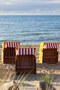 Beach chairs three at the baltic sea in the evening Royalty Free Stock Images