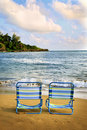 Beach Chairs on a Tropical Beach Royalty Free Stock Images
