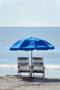 Beach chairs two empty alone by the ocean Royalty Free Stock Photo