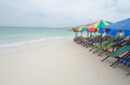 Beach chairs with umbrella and beautiful khai nok island phuket Royalty Free Stock Photo