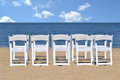 Beach chairs white folding on the Stock Images