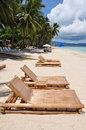 Beach chairs on white sand beach in Boracay Stock Photography