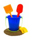 Beach collection toy sand pail with shovels and rake over a white background Royalty Free Stock Photos