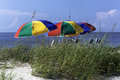 Beach colors multicolored umbrellas against ocean and sky Royalty Free Stock Image