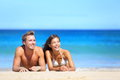 Beach couple looking Royalty Free Stock Image