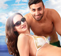 Beach couple smiling holiday a closeup portrait Royalty Free Stock Image