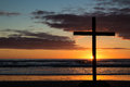 Beach cross at as the warm sun goes down Stock Photo