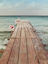 Beach dock with signals no swimming vertical Royalty Free Stock Photo