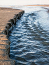 Beach erosion picture of at work Royalty Free Stock Photo