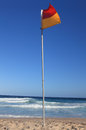 Beach flag red and yellow flapping in the breeze Royalty Free Stock Photography