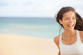 Beach fun running woman closeup with copy space happy smiling joyful elated girl jogging and laughing while training outdoors on Royalty Free Stock Photo