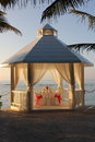 Beach gazebo a tropical at sunrise set and ready for a romantic breakfast for two Royalty Free Stock Image
