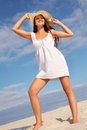 Beach girl beautiful young woman in white dress and hat standing on sandy Royalty Free Stock Images