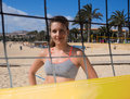 Beach girl smiling behind the volleyball net Royalty Free Stock Photo