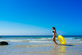 Beach girl walking along the seashore in cadiz enjoying free time with yellow float valdevaqueros atlantic ocean tarifa Royalty Free Stock Photography